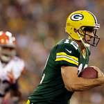Green Bay Packers' Aaron Rodgers runs during the first half of a preseason NFL football game against the Cleveland Browns Thursday, Aug. 16, 2012, in Green Bay, Wis. (AP Photo/Jeffrey Phelps …