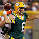 Cleveland Browns' Auston English (94) causes Green Bay Packers quarterback Graham Harrell to intentionally ground the ball from the end zone for a safety during the second half of a preseaso …
