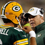 Green Bay Packers head coach Mike McCarthy talks to quarterback Graham Harrell during the first half of a preseason NFL football game against the Cleveland Browns Thursday, Aug. 16, 2012, in …