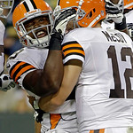 Cleveland Browns quarterback Colt McCoy (12) congratulates running back Brandon Jackson (29) after Jackson's touchdown run during the second half of a preseason NFL football game against the …