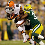 Green Bay Packers' Anthony Levine tackles Cleveland Browns' Greg Little (15) during the first half of a preseason NFL football game Thursday, Aug. 16, 2012, in Green Bay, Wis. (AP Photo/Jeff …