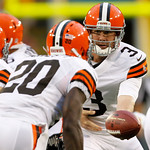 Cleveland Browns quarterback Brandon Weeden hands off during the first half of a preseason NFL football game against the Green Bay Packers Thursday, Aug. 16, 2012, in Green Bay, Wis. (AP Pho …