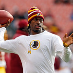 Washington Redskins quarterback Robert Griffin III tosses a ball during warmups before an NFL football game against the Cleveland Browns in Cleveland, Sunday, Dec. 16, 2012. Kirk Cousins wil …