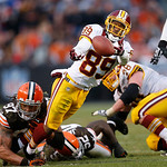 Washington Redskins wide receiver Santana Moss (89) fumbles after being hit by Cleveland Browns defensive end Jabaal Sheard (97) and linebacker D'Qwell Jackson (52) in the fourth quarter of …