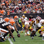 Cleveland Browns center Alex Mack (55) prepares to snap the ball to quarterback Brandon Weeden in the first quarter of an NFL football game against the Washington Redskins Sunday, Dec. 16, 2 …