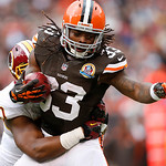 Cleveland Browns running back Trent Richardson (33) is tackled by Washington Redskins linebacker Rob Jackson in the second quarter of an NFL football game in Cleveland, Sunday, Dec. 16, 2012 …