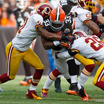 Cleveland Browns running back Trent Richardson (33) runs the ball as Washington Redskins cornerback Josh Wilson (26) and free safety Madieu Williams (41) tackle him during an NFL football ga …