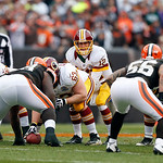 Washington Redskins quarterback Kirk Cousins (12) calls signals at the line in the second quarter of an NFL football game against the Cleveland Browns in Cleveland, Sunday, Dec. 16, 2012. (A …