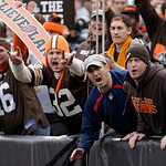 Cleveland Browns fans react after an interception by safety T.J. Ward in the first quarter of an NFL football game against the Washington Redskins Sunday, Dec. 16, 2012, in Cleveland. (AP Ph …