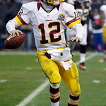 Washington Redskins quarterback Kirk Cousins looks for an open receiver in the third quarter of an NFL football game against the Cleveland Browns, Sunday, Dec. 16, 2012, in Cleveland. (AP Ph …