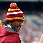 Injured Washington Redskins quarterback Robert Griffin III talks to teammates on the sidelines in the second quarter of an NFL football game against the Cleveland Browns in Cleveland, Sunday …