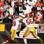 Cleveland Browns tight end Benjamin Watson (82) makes a reception as Washington Redskins inside linebacker London Fletcher (59) and inside linebacker Perry Riley (56) defend in the first hal …