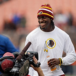 Injured Washington Redskins quarterback Robert Griffin III watches warmups before an  NFL football game against the Cleveland Browns Sunday, Dec. 16, 2012, in Cleveland. Kirk Cousins will st …