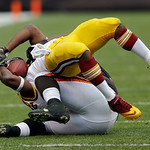 Washington Redskins running back Alfred Morris, top is brought down by Cleveland Browns linebacker L.J. Fort in the first quarter of an NFL football game Sunday, Dec. 16, 2012, in Cleveland. …