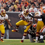 Washington Redskins running back Alfred Morris, center, runs against the Cleveland Browns in the first quarter of an NFL football game Sunday, Dec. 16, 2012, in Cleveland. (AP Photo/Mark Dun …