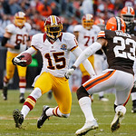Washington Redskins wide receiver Josh Morgan (15) tries to elude Cleveland Browns cornerback Joe Haden (23) on a short pass in the fourth quarter of an NFL football game in Cleveland, Sunda …