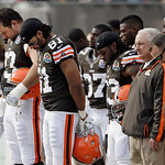 Cleveland Browns offensive tackle Joe Thomas, left, tight end Alex Smith (81),and running back Trent Richardson (33) join their teammates in a moment of silence for the victims of the Conne …