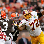 Washington Redskins defensive end Stephen Bowen (72) tries to get a hand on Cleveland Browns quarterback Brandon Weeden (3) in the second quarter of an NFL football game in Cleveland, Sunday …