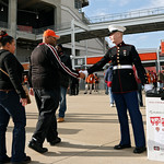 Marine Brennen O'Neill greets fans entering Cleveland Browns Stadium befor an NFL football game between the Washington Redskins and the Cleveland Browns Sunday, Dec. 16, 2012, in Cleveland. …