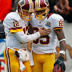 Washington Redskins quarterback Kirk Cousins (12) congratulates wide receiver Leonard Hankerson after a 54-yard touchdown pass in the first quarter of an NFL football game against the Clevel …