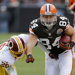 Cleveland Browns tight end Jordan Cameron (84) eludes Washington Redskins cornerback Josh Wilson (26) in the third quarter of an NFL football game Sunday, Dec. 16, 2012, in Cleveland. (AP Ph …