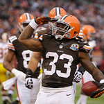 Cleveland Browns running back Trent Richardson salutes the fans after scoring on a 1-yard touchdown run against the Washington Redskins in the second quarter of an NFL football game Sunday, …