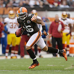 Cleveland Browns wide receiver Josh Cribbs runs the ball against the Washington Redskins during an NFL football game Sunday, Dec. 16, 2012, in Cleveland. (AP Photo/Tony Dejak)