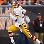 Washington Redskins quarterback Kirk Cousins (12) runs the ball against the Cleveland Browns in the first half of an NFL football game in Cleveland, Sunday, Dec. 16, 2012. (AP Photo/Rick Ose …