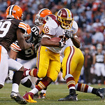Washington Redskins running back Alfred Morris (46) breaks past Cleveland Browns cornerback Tashaun Gipson (39) on an 8-yard touchdown run in the fourth quarter of an NFL football game in Cl …