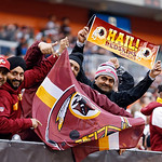 Washington Redskins fans cheer in the fourth quarter of an NFL football game against the Cleveland Browns in Cleveland, Sunday, Dec. 16, 2012. (AP Photo/Rick Osentoski)
