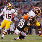 Washington Redskins running back Alfred Morris (46) drags Cleveland Browns cornerback Tashaun Gipson (39) into the end zone on an 8-yard touchdown run in the fourth quarter of an NFL footbal …