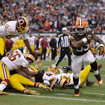 Cleveland Browns running back Trent Richardson (33) scores on a 1-yard touchdown against the Washington Redskins run in the second quarter of an NFL football game Sunday, Dec. 16, 2012, in C &#8230;