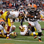 Cleveland Browns running back Trent Richardson (33) scores on a 1-yard touchdown run against the Washington Redskins in the second quarter of an NFL football game on Sunday, Dec. 16, 2012, i &#8230;
