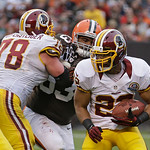 Washington Redskins running back Evan Royster (22) breaks away on a 4-yard touchdown run against the Cleveland Browns in the fourth quarter of an NFL football game on Sunday, Dec. 16, 2012, …