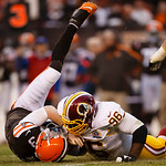 Washington Redskins nose tackle Barry Cofield (96) sacks Cleveland Browns quarterback Brandon Weeden (3) in the fourth quarter of an NFL football game in Cleveland, Sunday, Dec. 16, 2012. (A …