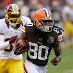Cleveland Browns wide receiver Travis Benjamin (80) runs away from Washington Redskins cornerback DJ Johnson on a 69-yard touchdown reception in the fourth quarter of an NFL football game Su …