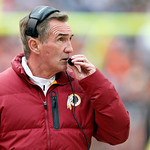 Washington Redskins head coach Mike Shanahan talks over his headset on the sidelines in the second quarter of an NFL football game against the Cleveland Browns in Cleveland, Sunday, Dec. 16, …