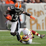 Cleveland Browns wide receiver Josh Gordon (13) is tripped up by Washington Redskins cornerback Josh Wilson after a pass reception in the fourth quarter of an NFL football game Sunday, Dec. …