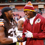 Washington Redskins quarterback Robert Griffin III, right, laughs with Cleveland Browns running back Trent Richardson (33) after the Redskins' 38-21 win in an NFL football game in Cleveland, …
