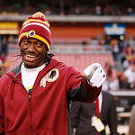 Washington Redskins quarterback Robert Griffin III, left, jokes with Cleveland Browns defensive end Juqua Parker, not seen, after the Redskins' 38-21 win on an an NFL football game in Clevel …
