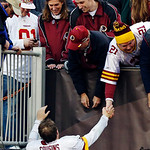 Washington Redskins quarterback Kirk Cousins (12) greets fans after their 38-21 win over the Cleveland Browns in an NFL football game in Cleveland, Sunday, Dec. 16, 2012. Cousins threw for 3 &#8230;
