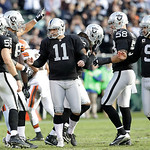 Oakland Raiders place kicker Sebastian Janikowski (11) is congratulated after kicking a 51-yard field goal during the first half of an NFL football game against the Cleveland Browns in Oakla …