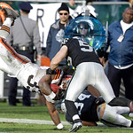 Cleveland Browns running back Trent Richardson (33) dives in front of Oakland Raiders linebacker Miles Burris (56) during the third quarter of an NFL football game in Oakland, Calif., Sunday …