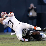 Oakland Raiders defensive end Lamarr Houston (3) sacks Cleveland Browns quarterback Brandon Weeden (3) during the fourth quarter of an NFL football game in Oakland, Calif., Sunday, Dec. 2, 2 …