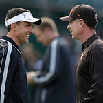 Oakland Raiders head coach Dennis Allen, left, smiles as he talks to Cleveland Browns head coach Pat Shurmur before an NFL football game in Oakland, Calif., Sunday, Dec. 2, 2012. (AP Photo/M …