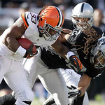 Cleveland Browns running back Trent Richardson (33) runs against Oakland Raiders linebacker Philip Wheeler (52) during the first quarter of an NFL football game in Oakland, Calif., Sunday, D …