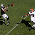 Oakland Raiders defensive back Matt Giordano (27) intercepts a pass from Cleveland Browns quarterback Brandon Weeden intended for tight end Benjamin Watson (82) during the first quarter of a …
