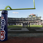 An NFL Play 60 sign is shown on a goal post sign at O.co Coliseum during the first half of an NFL football game between the Oakland Raiders and the Cleveland Browns in Oakland, Calif., Sunda …