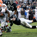 Cleveland Browns running back Trent Richardson (33) scores on a 3-yard touchdown run past Oakland Raiders defensive end Matt Shaughnessy (77) during the fourth quarter of an NFL football gam …