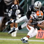 Cleveland Browns cornerback Sheldon Brown (24) is tackled by Oakland Raiders wide receiver Juron Criner (84) after intercepting a pass by quarterback Carson Palmer during the fourth quarter  …
